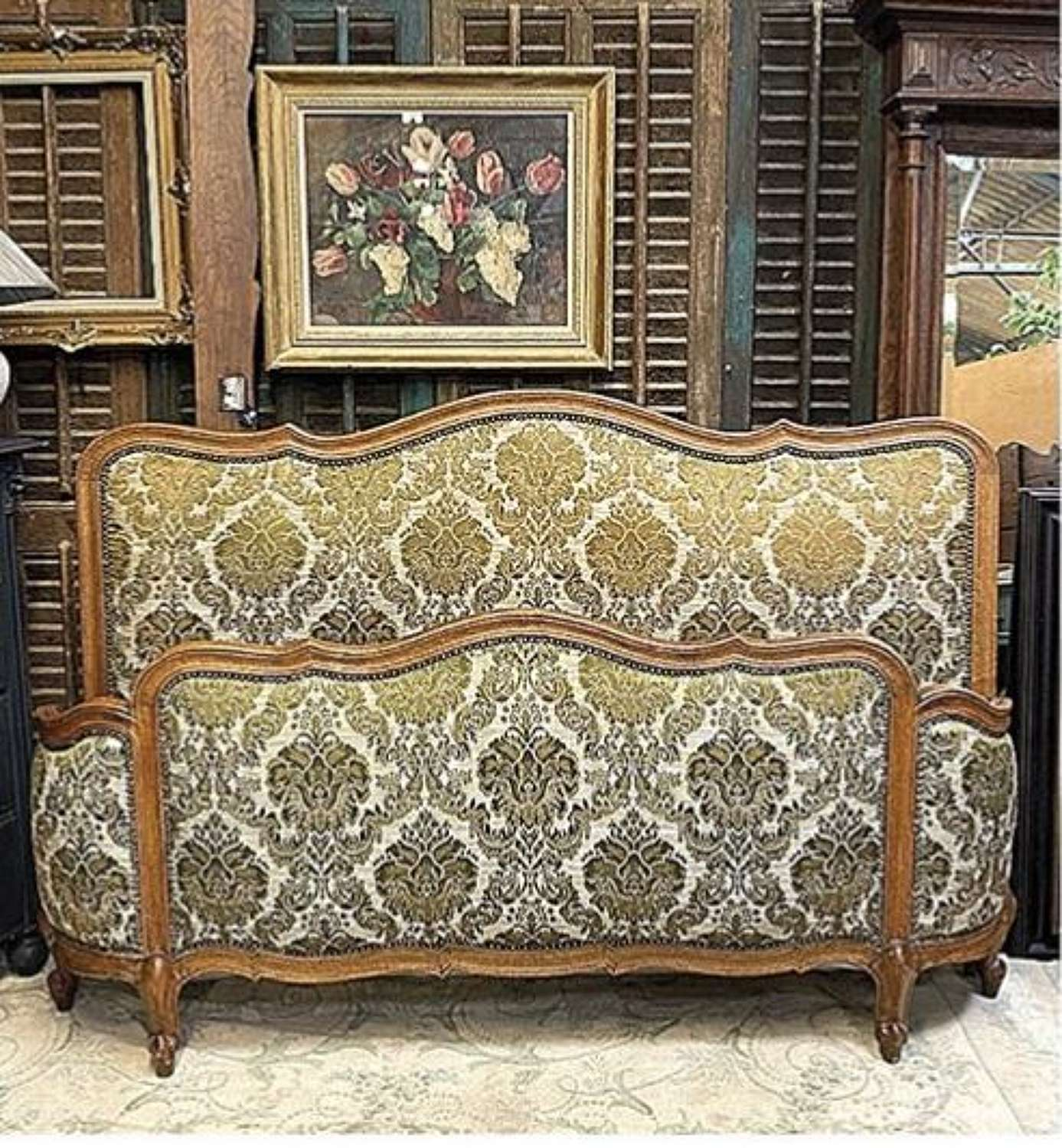 A king size french corbeille bed with a green jacquard fabric