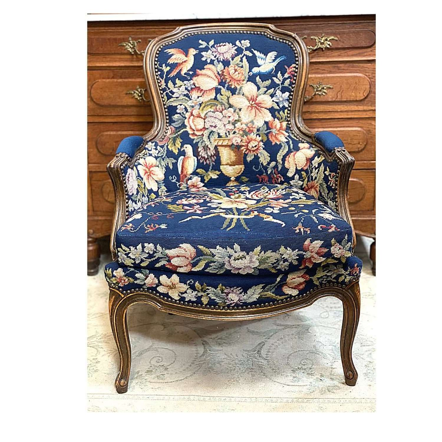 Vintage armchair with a royal blue tapestry