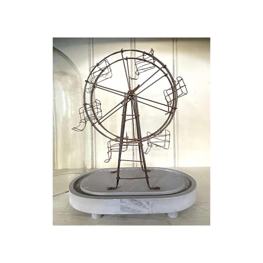 Vintage Ferris wheel under glass dome