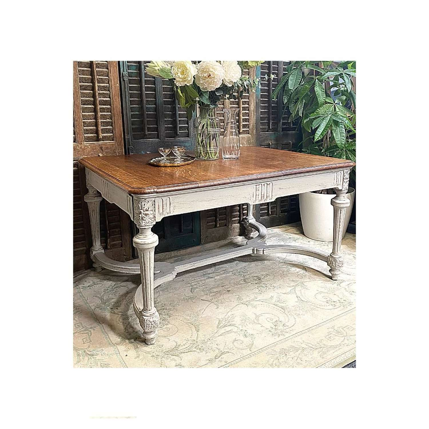 Solid oak dining table with a painted base