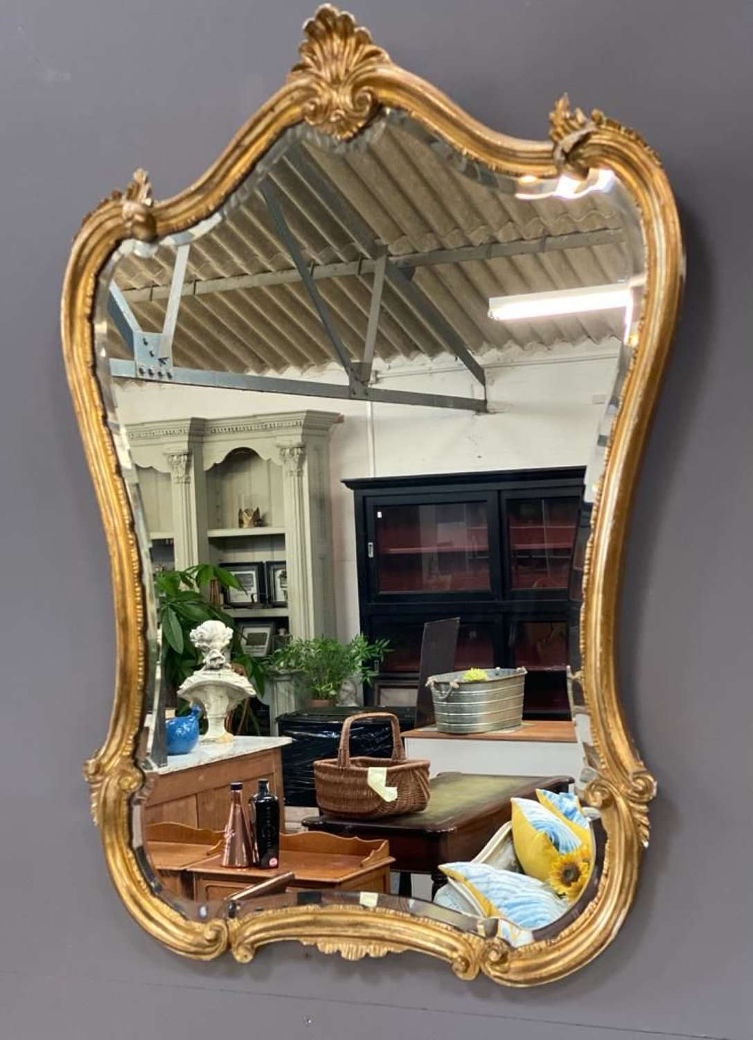 Shaped vintage gold french mirror