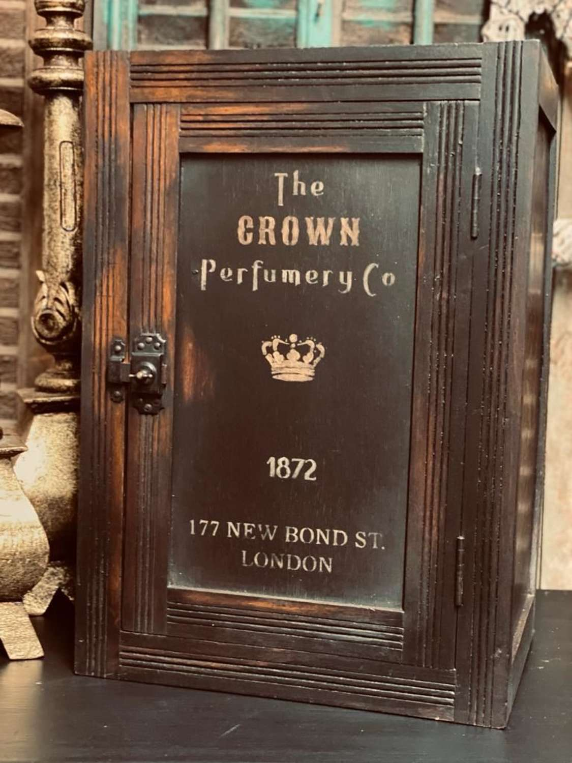 Painted crown perfume cabinet