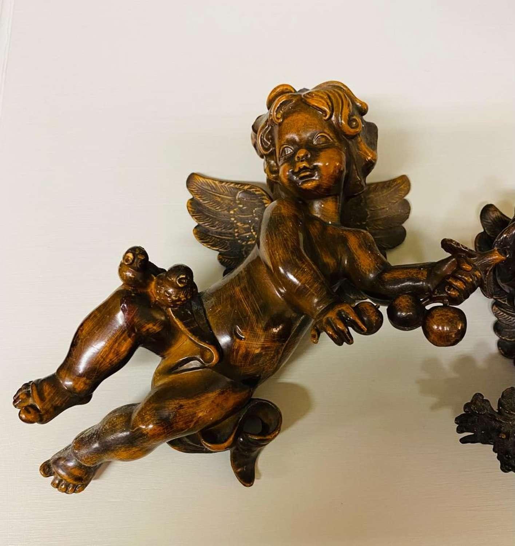 Pair of decorative cherubs
