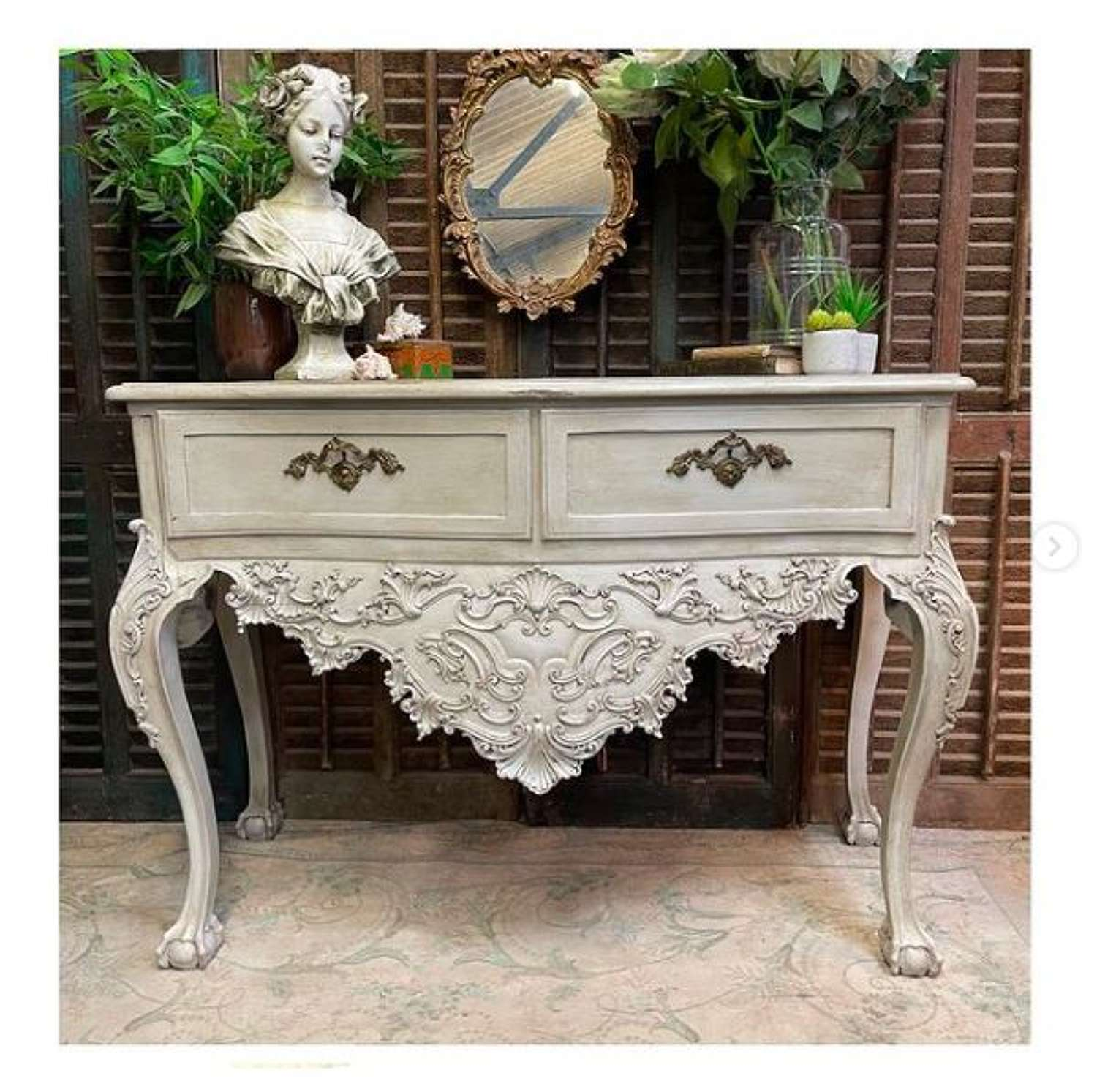 Overly carved French style side table or console.