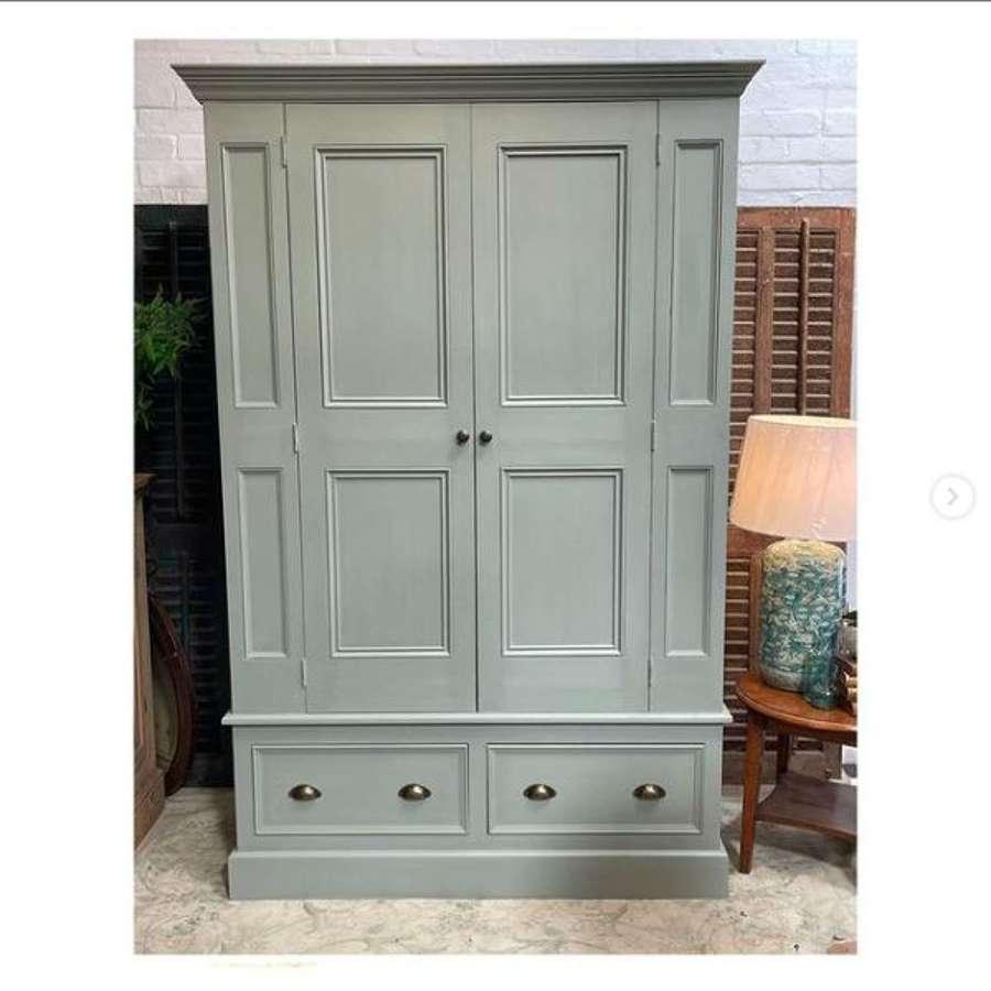 Regency style panelled wardrobe with drawers below.