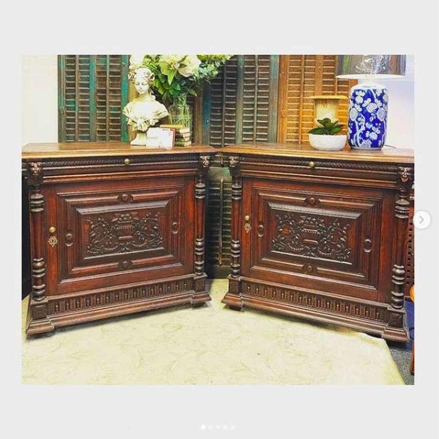 Carved oak cabinets.